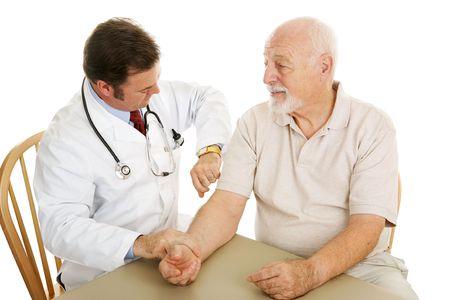 Doctor checking senior man's pulse.  White background. Stock Photo - 3190619