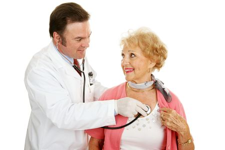Doctor using a stethoscope to listen to a senior woman's heart beat.  Isolated on white. Stock Photo - 3190611