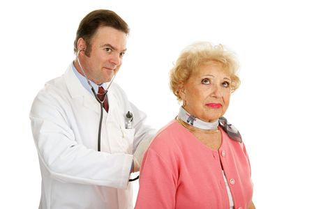 Senior lady getting a checkup from her doctor.  Isolated on white.   Stock Photo - 3190618