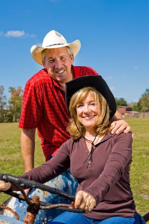 Portrait of a beautiful mature couple on the farm. photo