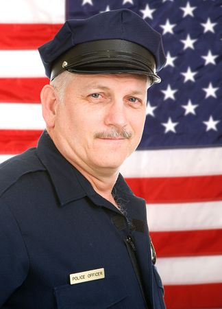 deputy sheriff: Handsome mature policeman in uniform, against an American Flag.