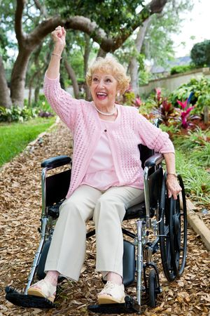 Disabled senior lady in pink, excited about achieving her health goals. Stock Photo - 3235021