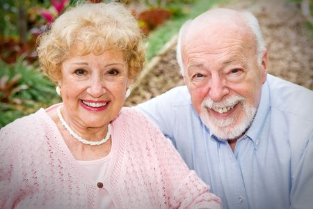 Portrait of a beautiful, happy senior couple outdoors in the garden. Stock Photo - 3235006