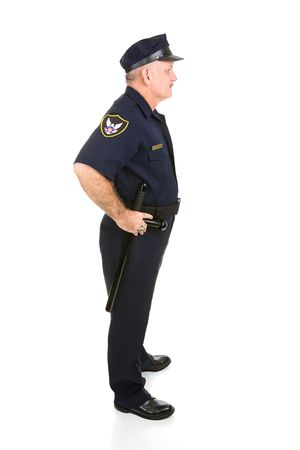 Handsome mature police officer in profile.  Full body isolated on white.   Stock Photo - 3235000