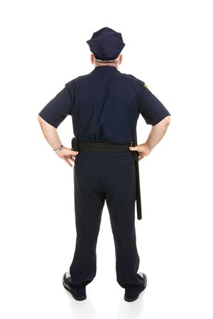 Rear view of a mature police officer in uniform.  Full body isolated on white.