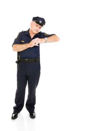 Handsome, mature policeman isolated, leaning on blank white space.  Insert your sign.   photo