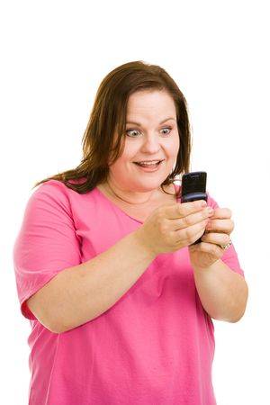 plus sized: Pretty plus sized model amazed by the features of her new cell phone, or by a text message shes reading.  Isolated on white.