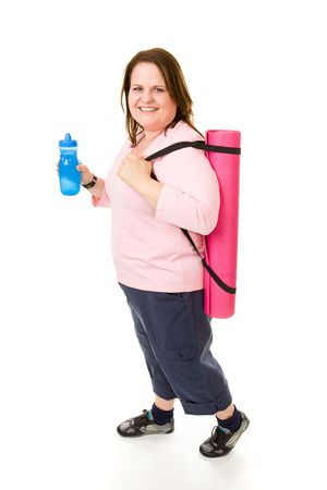 plus sized: Pretty plus sized model on her way to the gym with yoga mat and water bottle.  Full body isolated on white.   Stock Photo