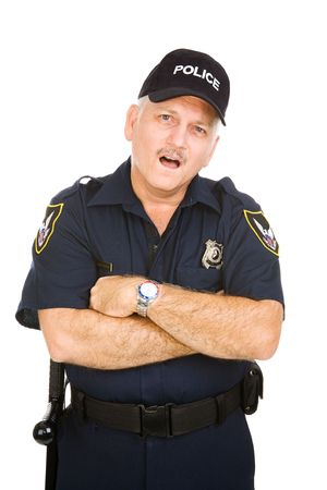 Police officer with his arms folded and an amazed expression.  Isolated on white. Stock Photo - 3302148