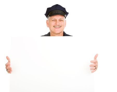 Handsome mature police officer (or security guard) holding a blank white sign.  Isolated on white and ready for your text.   photo