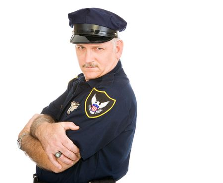 sexy police: Handsome policeman leaning back on invisible white space, with a sexy expression.  Isolated design element. Stock Photo
