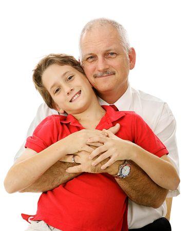 Hermoso maduro padre abrazando su adorable hijo. Aislado en blanco.  Foto de archivo - 3317980