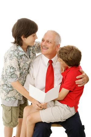 time of the day: Handsome dad getting a greeting card from his sons.  Perfect for fathers day or other occasion.   Stock Photo