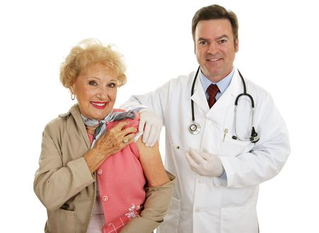 Senior woman receiving flu vaccine from a friendly doctor.  Isolated on white.