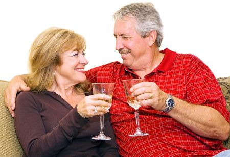 Romantic mature couple relaxing at home with wine. Stock Photo - 3335808