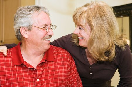 Happily married mature couple smiling and laughing together. Stock Photo - 3335815