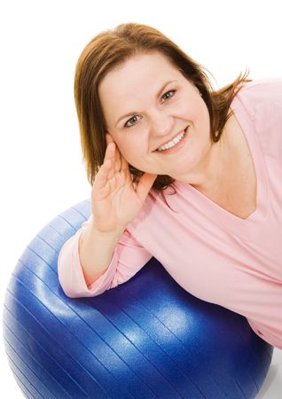 Beautiful plus sized woman resting on a pilates workout ball.  Isolated on white.