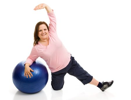 plus sized: Beautiful plus sized model exercising with a pilates ball.  Full body isolated on white.