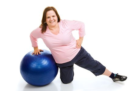 plus sized: Beautiful plus sized model working out with a pilates fitness ball.  Full body isolated on white. Stock Photo