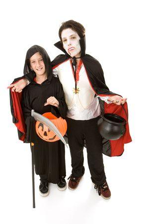Two adorable boys in their halloween costumes.  Full body isolated on white.   photo