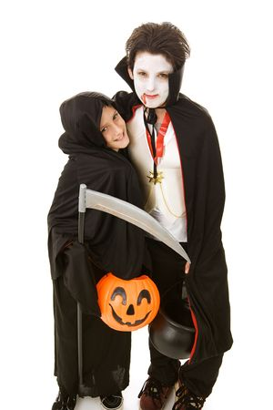 Two adorable boys dressed in their halloween costumes.  Full body isolated on white.   photo
