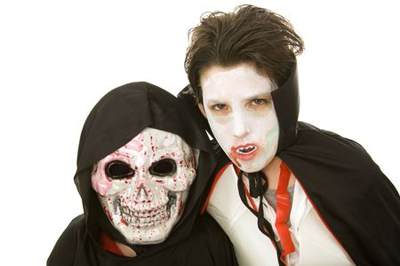 Portrait of two boys dressed in scary Halloween costumes.  Isolated on white.   photo