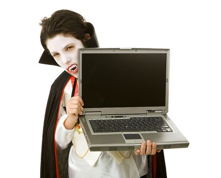 Cute Halloween vampire holding a laptop computer over white background.  LCD screen is blank and ready for your text.   photo