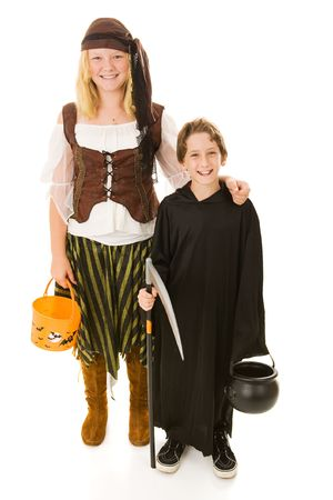treating: Big sister ready to take her little brother trick or treating on Halloween.  Full body isolated on white.   Stock Photo