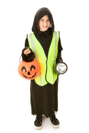 Adorable little boy in his Halloween costume with a reflective vest and flashlight for trick or treating safety.  Full body isolated on white.   photo