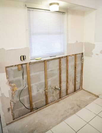 Kitchen remodeling project.  Drywall had to be removed because of mold resulting from water damage.   Stock Photo