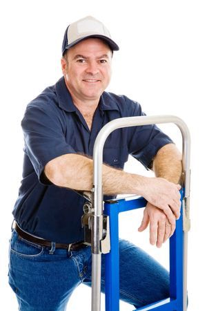Friendly, casual delivery person or mover relaxing on his hand truck.  Isolated on white.   Stock Photo