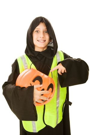 treating: Adorable little boy in his halloween costume, wearing a reflective vest for safe trick or treating.    Isolated on white.   Stock Photo