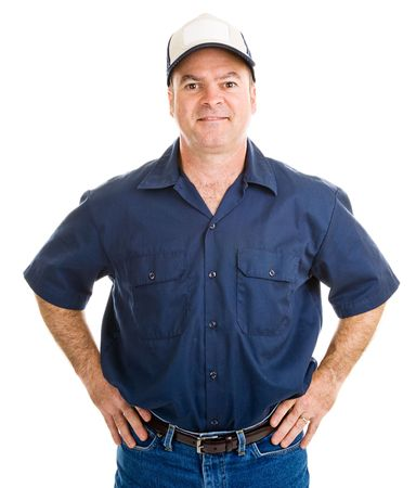 Handsome service man with his hands on his hips.  Isolated on white.
