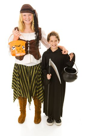Adorable little boy in halloween costume getting ready to trick or treat with his sister.  Full body isolated on white.   photo