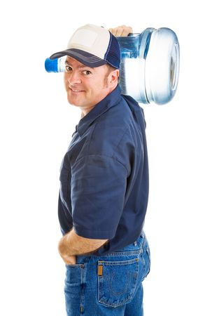 carrying: Handsome, friendly water delivery man carrying a 5 gallon jug on his shoulder.  Isolated on white.