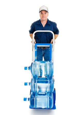 hand truck: Delivery man with fifteen gallons of drinking water on a hand truck.  Full body isolated on white.   Stock Photo