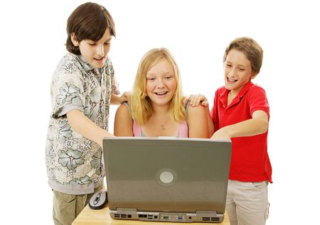 A group of kids having fun using a laptop computer.  Isolated on white. photo
