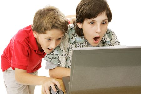 inappropriate: Two brothers shocked by what they are seeing on the internet.  Isolated on white.