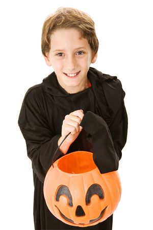 Adoroable little boy dressed for halloween and ready to trick or treat.  Isolated on white.   photo