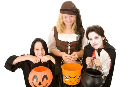 Three adorable trick or treaters begging for Halloween candy.  Isolated on white background. photo