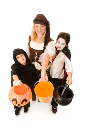 Adorable trick or treaters in halloween costumes, begging for candy.  Full body isolated on white. photo