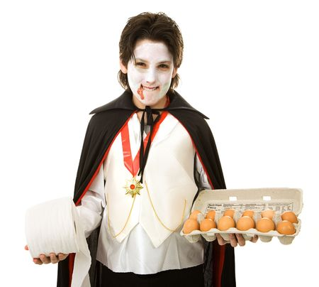 Mischievous adolescent boy ready to play halloween tricks with eggs and toilet paper.  Isolated on white. Stock Photo - 3520744