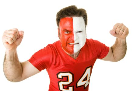 yell: Angry sports fan with a painted face, raising his fists and growling aggressively.