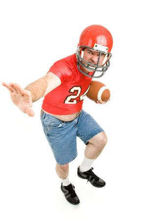 school football: Middle aged man in his high school football jersey and helmet, reliving his past.  Isolated on white.