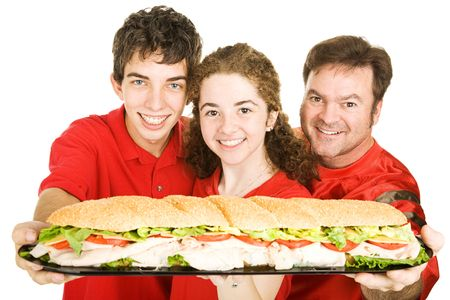 hoagie: Football fans holding a giant submarine sandwich.  Isolated on white.   Stock Photo
