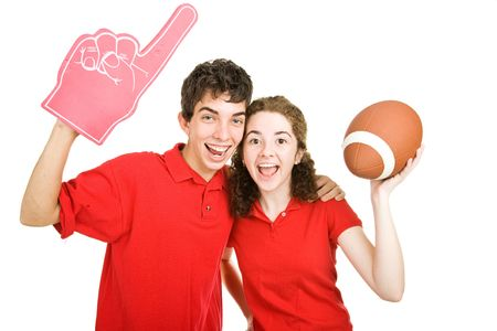 Cute teen couple excitely cheering for their football team.  Isolated on white. Stock Photo - 3548371