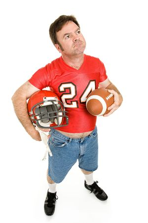 the old days: Football fan in his old high school jersey, remembering the good old days.  Full body isolated on white.   Stock Photo