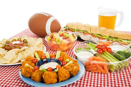 hoagie: Table spread with appetizer trays for the footbal party.  Horizontal view over white background.