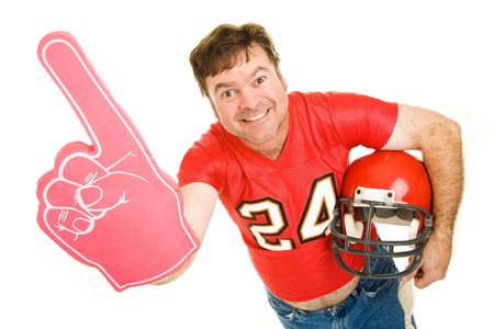 fanatic: Enthusiastic middle aged football fan wearing his old high school jersey and holding a helmet and a foam finger.  Isolated on white.