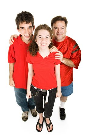 Teen couple and the girls father dressed in red, supporting their favorite sports team.  Full body isolated on white. photo